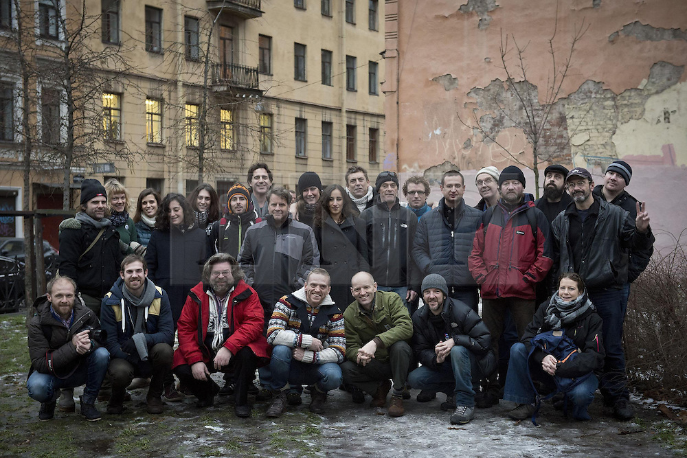 © Licensed to London News Pictures. 03/12/2013. Russia, UK A Group shot of 26 of the Arctic 30 (24 Greenpeace International activists and two freelance journalists) in St.Petersburg. Missing from the original 30 in the picture are:- Francesco Pisanu (France), Andrey Allakhverdov (Russia), Tomasz Dziemianczuk (Poland) and Ekaterina Zaspa (Russia).. Photo credit : Dmitri Sharomov / Greenpeace/LNP
