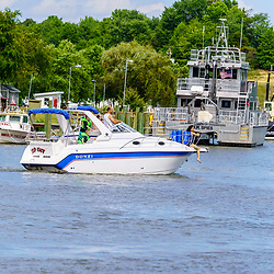 Chesapeake City, MD, USA - June 28. 2020: A pleasure boat moves through the Chesapeake and Delaware Canal.