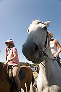 two women horseback riding