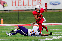 NORMAL, IL - October 06: Spencer Schnell steps over and away from Darron Wheeler and continues up the field during a college football game between the ISU (Illinois State University) Redbirds and the Western Illinois Leathernecks on October 06 2018 at Hancock Stadium in Normal, IL. (Photo by Alan Look)