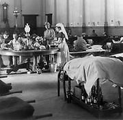 Second Boer War 1899-1902: 'Where the sick and wounded British soldiers are cared for' - interior of the Raadzaal, Bloemfontein, South Africa 1900.  Medicine Hospital Military Nurse