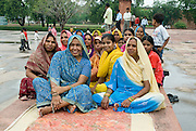 India, Delhi, Local women in colourful traditional dress in a park