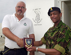 After having thier shower and toilet facilities renovated on South Mold,  PC Joseph Lavagna says thank you to the 106 (WR) Field Squadron (Air Support) Royal Engineers on behalf of the Gibraltar Services Police. Recieving the plaque is 2 Lt. Kim Mbugua. The 106 were on South Mold to work on the istallation of a new Visial and Audio warning Becon for Shipping.<br /><br />Image Copyright Paul David Drabble<br /><br />8 June 2003<br /><br />Copyright  Paul David Drabble<br />[#Beginning of Shooting Data Section]<br />Nikon D1 <br />2003/06/05 0
