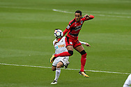 Tom Ince of Huddersfield Town controls the ball ahead of Leon Britton of Swansea city. Premier league match, Swansea city v Huddersfield Town at the Liberty Stadium in Swansea, South Wales on Saturday 14th October 2017.<br /> pic by  Andrew Orchard, Andrew Orchard sports photography.