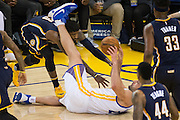 Golden State Warriors center Zaza Pachulia (27) fights for a loose ball against the Indiana Pacers at Oracle Arena in Oakland, Calif., on December 5, 2016. (Stan Olszewski/Special to S.F. Examiner)