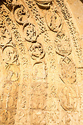Carved stonework in entrance archway of Malmesbury abbey church, Malmesbury, Wiltshire, England, UK