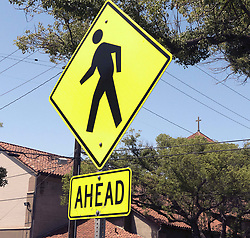 June 19, 2017 - Santa Ana, CA, USA - Yellow crosswalk warning signs warn of possible pedestrian foot traffic on Civic Center Drive near Saint Joseph Church where a woman died after being hit by a car Saturday evening as she crossed Civic Center Drive near Lacy Street in downtown Santa Ana, CA on Monday, June 19, 2017. (Credit Image: © Ken Steinhardt/The Orange County Register via ZUMA Wire)