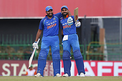 August 31, 2017 - Colombo, Sri Lanka - Indian cricket captain Virat Kohli (R) celebrates after scoring 100 runs as Rohit Sharma (L) joins in  during the 4th One Day International cricket match between Sri Lanka and India at the R Premadasa international cricket stadium at Colombo, Sri Lanka on Thursday 31 August 2017. (Credit Image: © Tharaka Basnayaka/NurPhoto via ZUMA Press)