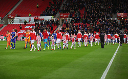 The teams walk out onto the pitch ahead of the Sky Bet Championship match at the bet365 Stadium in Stoke.