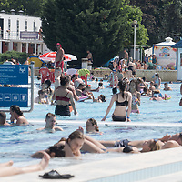 People enjoy the outdoor pools in the 34 degree Celsius heat summer after the COVID-19 restrictions were lifted at Palatinus Bath in Budapest, Hungary on June 28, 2020. ATTILA VOLGYI
