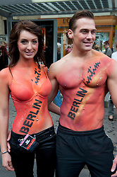 Couple with body paint  posing at  the Christopher Street Day Parade in Berlin Germany 2011