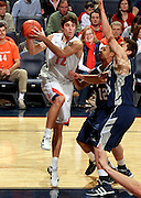 CHARLOTTESVILLE, VA- December 3: Joe Harris #12 of the Virginia Cavaliers handles the ball during the game on December 27, 2011 against the Longwood Lancers at the John Paul Jones Arena in Charlottesville, Virginia. Virginia defeated Longwood 86-53. (Photo by Andrew Shurtleff/Getty Images) *** Local Caption *** Joe Harris