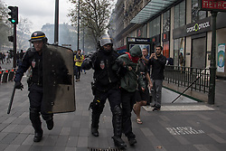 September 15, 2016 - Paris, France - A man is taken by the national french police during police riot in Paris on September 15, 2016 . Parisians took out the streets this Thursday to make a new demonstration over the so controversial Labor Law reform in France. Thousands gathered at Place de la Bastille for a peaceful walk to Place de la République, but as is usual, an anarchist group clashed in a confrontation with police that lasted all the way. (Credit Image: © David Cordova/NurPhoto via ZUMA Press)