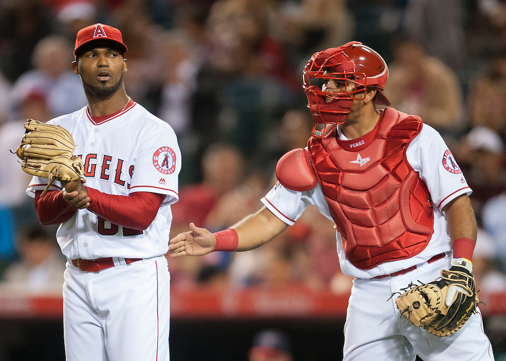 The Angels' Al Alburquerque talks with catcher Carlos Perez during the seventh inning against the Minnesota Twins Monday at Angel Stadium.<br /> <br /> ///ADDITIONAL INFO:   <br /> <br /> angels.0614.kjs  ---  Photo by KEVIN SULLIVAN / Orange County Register  -- 6/13/16<br /> <br /> The Los Angeles Angels take on the Minnesota Twins Monday at Angel Stadium.