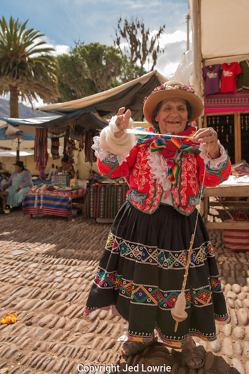 This local Quechua woman was more than excited to pose for a picture in the middle of the the marker in Pisac.  The wool must be spun to turn it into useable yarn.