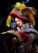 Gaston De Cardenas/El Nuevo Herald -- In a scene from act I of the Florida Grand Opera production of Mozart's Don Giovanni Donna Elvira played by Kelly Kaduce, a woman Giovanni once seduced in Burgos and is on his trail, reads the long catalog of the lustful Don's conquests.