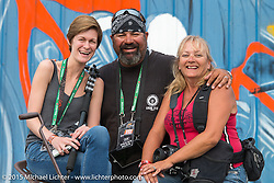 Photo Assistants (L-R) Shannon Kerr, Garrett Stanley and Melissa Shoemaker at the Full Throttle Saloon during the 75th Annual Sturgis Black Hills Motorcycle Rally.  SD, USA.  August 7, 2015.  Photography ©2015 Michael Lichter.
