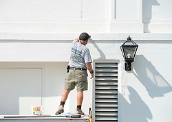 Contractor paints one of the outside walls on the West Wing of the White House in Washington, DC, USA, on Tuesday, August 22, 2017. Photo by Ron Sachs/CNP/ABACAPRESS.COM
