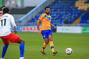 Mal Benning of Mansfield Town (3) passes the ball during the The FA Cup match between Mansfield Town and Dagenham and Redbridge at the One Call Stadium, Mansfield, England on 29 November 2020.
