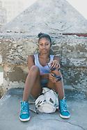 Claudia, age 20, sitting on the Malecon in Havana, Cuba. (December 3, 2014)