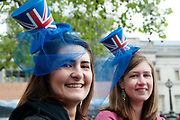 April 29th 2011 Royal Wedding. Trafalgar Square. Young women wearing blue veils and Union Jack hats