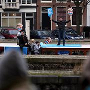 """NLD/Amsterdam/20080201 - Verjaardagsfeest Koninging Beatrix en prinses Margriet, protestactie '"""" Laat je snor staan'"""" tegen kanker door Aram van der Rest Mohammed Chaara en Dennis van der Geest"""