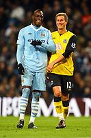 Football - Premier League - Manchester City vs. Blackburn Rovers<br /> Mario Balotelli of Manchester City shares a joke with Morten Gamst Pedersen of Blackburn Rovers at the Etihad Stadium