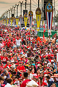 17 MAY 2014 - BANGKOK, THAILAND: Red Shirts gather on Aksa Road in Bangkok. Thousands of Thai Red Shirts, members of the United Front for Democracy Against Dictatorship (UDD), members of the ruling Pheu Thai party and supporters of the government of ousted Prime Minister Yingluck Shinawatra are rallying on Aksa Road in the Bangkok suburbs. The government was ousted by a court ruling earlier in the week that deposed Yingluck because the judges said she acted unconstitutionally in a personnel matter early in her administration. Thailand now has no functioning government. Red Shirt leaders said at the rally Saturday that any attempt to impose an unelected government on Thailand could spark a civil war. This is the third consecutive popularly elected UDD supported government ousted by the courts in less than 10 years.    PHOTO BY JACK KURTZ