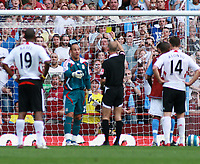 Photo: Mark Stephenson. <br /> Aston Villa v Liverpool. Barclays Premiership. 11/08/2007. <br /> Liverpool's keeper Pepe Reina gets a yellow card from referee  mr Mike Riley