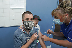 """© Licensed to London News Pictures. 03/07/2021. Sheffield, UK. Nick Davy,receives the second dose of the Pfizer/BioNTech vaccine at a pop-up vaccination clinic at Hillsborough Stadium in Sheffield as part of the """"Grab a jab"""" campaign. Photo credit: Ioannis Alexopoulos/LNP"""