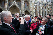 Jeremy Corbyn photographs Martin McGuinness and Gerry Adams from Sinn Fein greeting some of the mourners. The funeral of Tony Benn at St Margaret's Church Westminster Abbey. Tony Benn was a politician, MP and peace activist fighting for social justice.