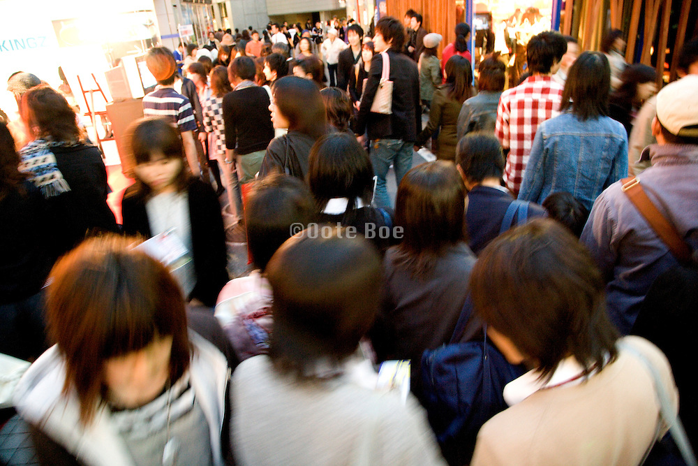 young people walking around in the Shibuya district of Tokyo Japan