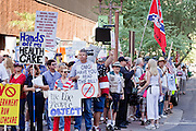 17 AUGUST 2009 -- PHOENIX, AZ: People opposed to President Obama and his policies gather at the corner of 2nd Street and Monroe.  About 5,000 people were expected to demonstrate in favor of President Obama's health care proposals. Nearly 1,500 showed up to demonstrate against the President.  PHOTO BY JACK KURTZ
