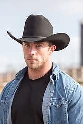 portrait of a rugged masculine cowboy outdoors