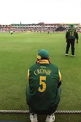 South Africa captain Hansie Cronje squats on the boundary