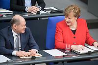 21 MAR 2019, BERLIN/GERMANY:<br /> Olaf Scholz (L), SPD, Bundesfinanzminister, Angela Merkel (R), CDU, Bundeskanzlerin, im Gespraech, Bundestagsdebatte zur Regierungserklaerung der Bundeskanzlerin zum Europaeischen Rat, Plenum, Deutscher Bundestag<br /> IMAGE: 20190321-01-065<br /> KEYWORDS: Gespräch