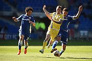 Millwall's Martyn Woolford © gets in between Cardiff's Fabio Da Silva (l) and Sean Morrison ®. Skybet football league championship, Cardiff city v Millwall at the Cardiff city stadium in Cardiff, South Wales on Saturday 18th April 2015<br /> pic by Andrew Orchard, Andrew Orchard sports photography.
