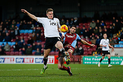 Matt Smith of Bristol City is challenged by Miguel Angel Llera of Scunthorpe United - Photo mandatory by-line: Rogan Thomson/JMP - 07966 386802 - 17/01/2015 - SPORT - FOOTBALL - Scunthorpe, England - Glanford Park - Scunthorpe United v Bristol City - Sky Bet League 1.