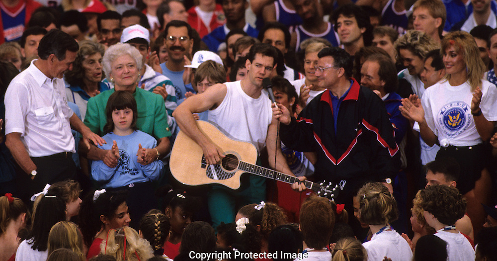 """As President and First Lady watch, Randy Travis performs at the """"Great American Workout"""" event held on the South Lawn of the White House..Photograph by Dennis Brack bb25"""