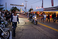Visitors and bikes head down Lakeside Avenue Friday evening.  (Karen Bobotas/for the Laconia Daily Sun)