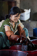 A Nepali woman works with dyed material at Womens Skills Development Project in Pokhara, Nepal. The WSDP was set up in 1975 as a non-profit, fair trade organization to help disadvantaged women in Nepal.