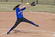 Middletown, New York - The Middletown pitcher winds up during a varsity girls' softball game on April 2, 2014.