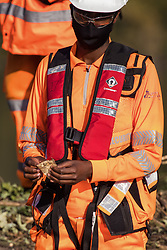 An HS2 security guard holds an item which a colleague had removed from the possessions of an anti-HS2 activist during tree felling works alongside HOAC lake in connection with the HS2 high-speed rail link on 21 September 2020 in Harefield, United Kingdom. Anti-HS2 activists continue to try to prevent or delay works for the controversial £106bn HS2 high-speed rail link on environmental and cost grounds from a series of protection camps based along the route of the line between London and Birmingham.