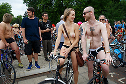 © Licensed to London News Pictures. 14/06/2014. LONDON, UK. Nude protesters getting ready to cycle through the streets of London on Saturday, 14 June 2014 as part of the World Naked Bike Ride event, which aims to raise awareness of cyclists on the roads and in the traffic. . Photo credit : Tolga Akmen/LNP