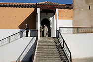 Morocco, Chefchaouen. Men in jellabas leaving the mosque.
