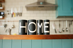 Word 'Home' on kitchen counter (Credit Image: © Image Source/Ian Nolan/Image Source/ZUMAPRESS.com)