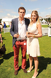 HUGH & ALICE FARQUHAR at the Cartier International Polo at Guards Polo Club, Windsor Great Park, Berkshire on 25th July 2010.