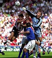 Fotball<br /> Premier League England<br /> 23.08.2003<br /> Foto: Digitalsport<br /> Norway Only<br /> <br /> Photo: Richard Lane.<br />Southampton v Birmingham City. Barclaycard Premiership.<br />23/08/2003.<br />Maik Taylor punches clear as James Beattie and Kevin Phillips challenge.