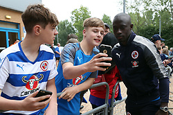 Reading's Modou Barrow (right) poses for a photograph with a fan before the Carabao Cup, first round match at the Madejski Stadium, Reading.