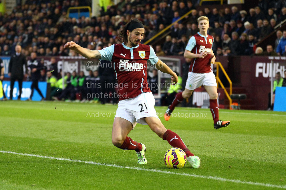 George Boyd of Burnley in action. Barclays Premier league match, Burnley v Liverpool at Turf Moor in Burnley, Lancs on Boxing Day, Friday 26th December 2014.<br /> pic by Chris Stading, Andrew Orchard sports photography.